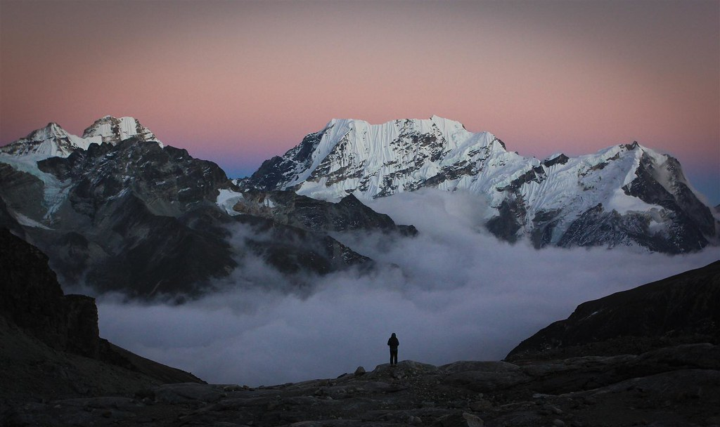 Dusk settles over the Mera La. Base camp at 5250m. Ekrate Danda Himal rising above the foggy Honggu Bassin. Makalu-Barun Conservation Area,