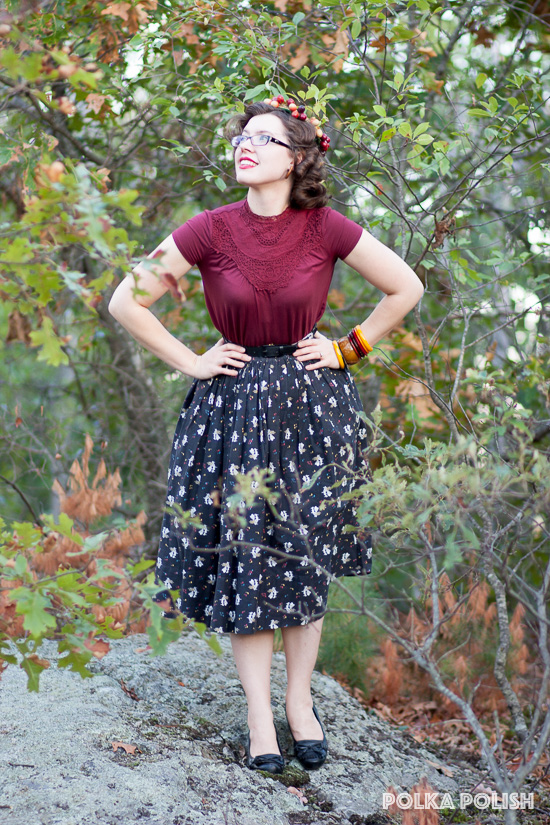 1950s fall outfit with a vintage music novelty print skirt with notes and pianos paired with a modern blouse