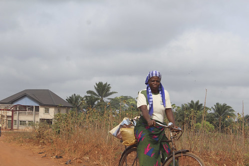 Igbo Mother Riding Her Bicycle by Jujufilms
