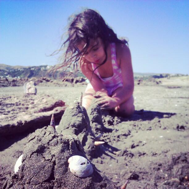 Making sand sculptures.