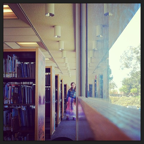 Perspective. Margie in the stacks. Well. Next to.