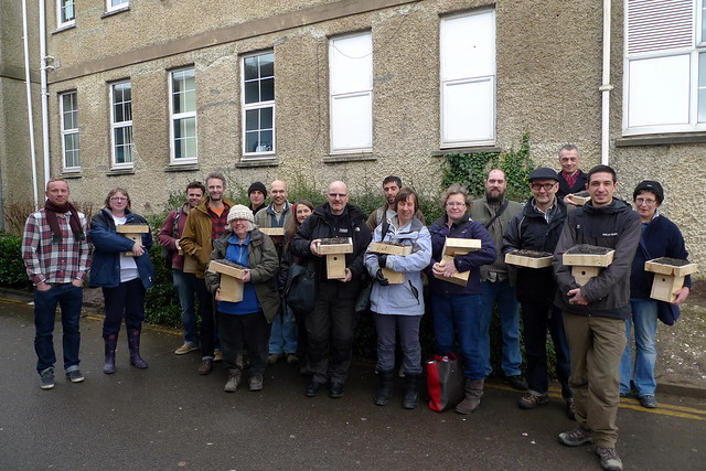 Proud participants with their green roofed bird boxes