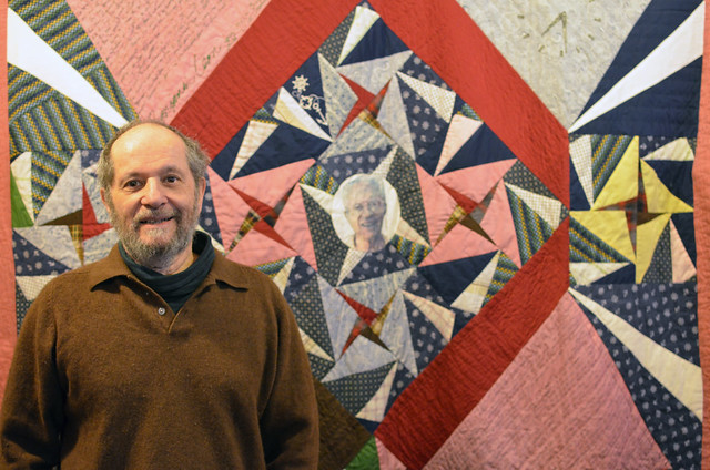 Eli with his father's memorial quilt
