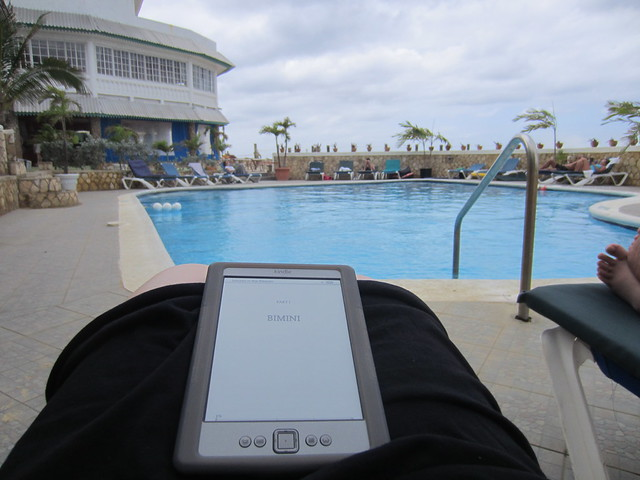 at the pool, reading Hemingway.