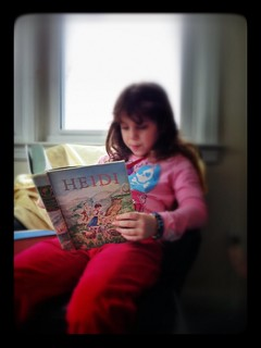 Reading my Illustrated Classics *Heidi*, which I got from my grandparents in 3rd grade.