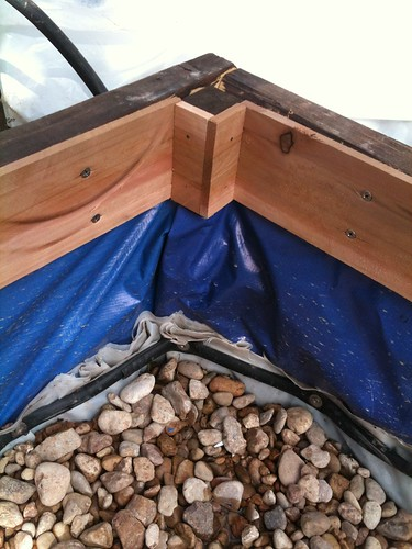 I cover the recycled billboard vinyl with rot-resistant cedar trim.