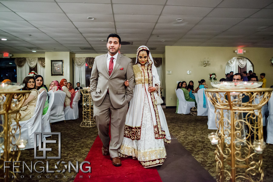 Bride and groom entering during the Valima reception