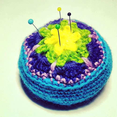 African flower pin cushion. Pattern from @ravelry