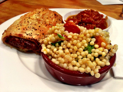 Home-made sausage roll with a side of pearl cous cous salad