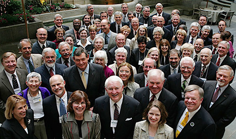 A crowd of mostly male college presidents