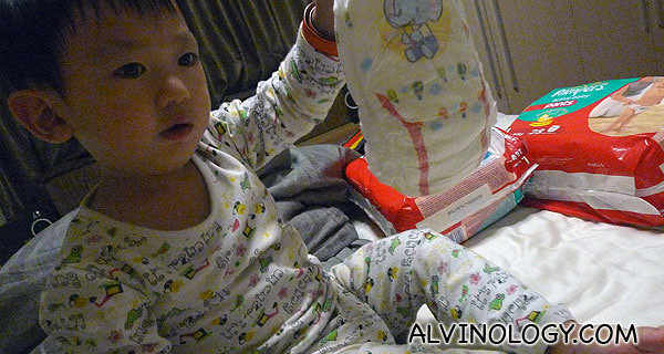 Asher picking the diaper with the cartoon he like to wear