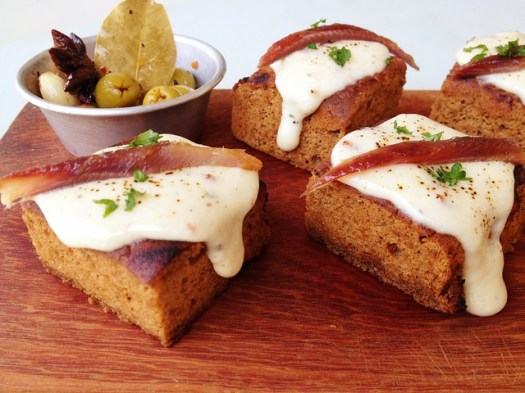 Rarebit morsels laced w anchovy tartare & crispy bacon cheese sauce
