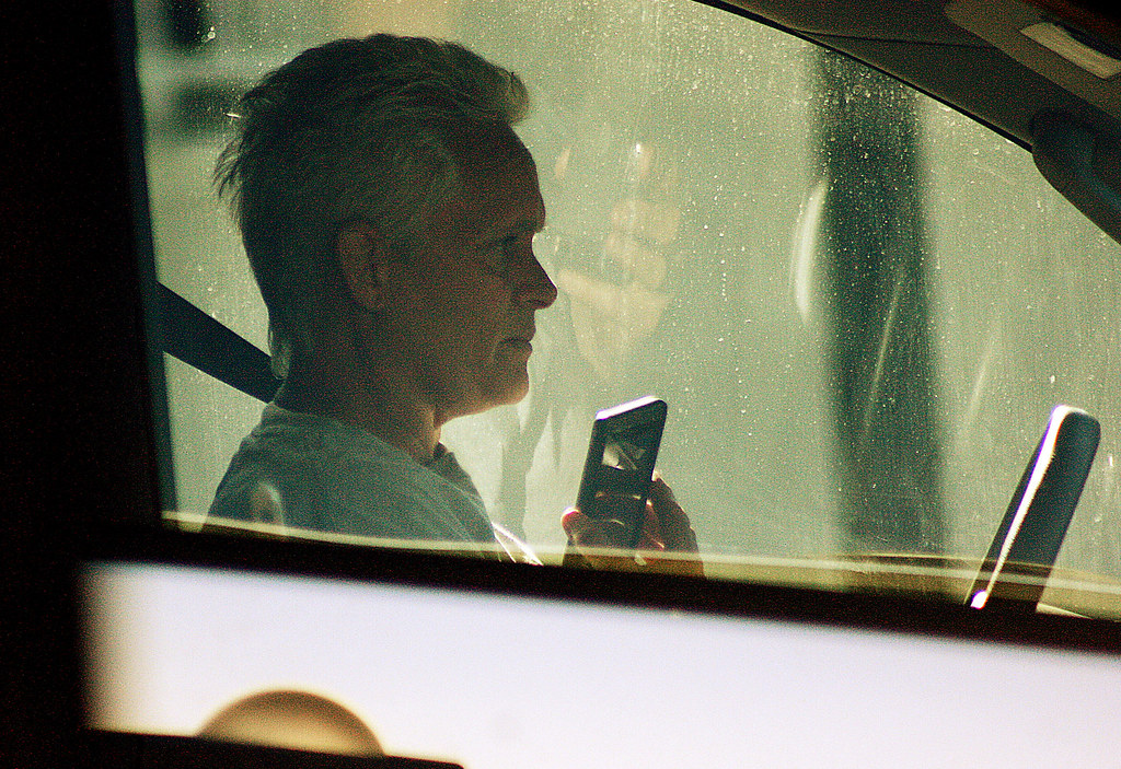 A driver talks on the phone while driving on Dolores Street in San Francisco on Monday, April 8 2013. Photo by Andy Sweet / Xpress