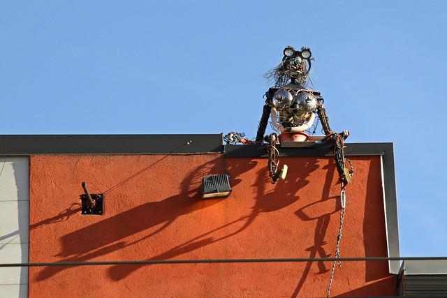 Something watching over Queen Street West in Toronto
