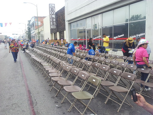parade chairs, being set up and tagged before the parade