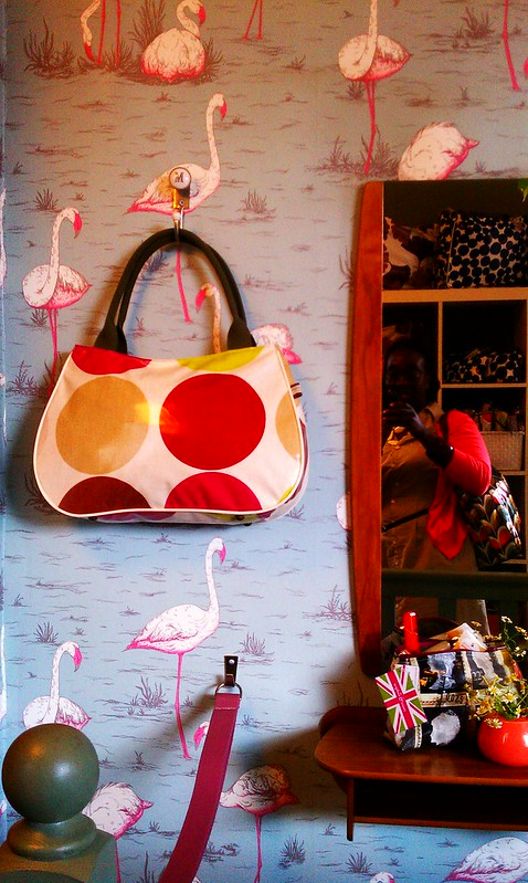 I WANT this purse, the wallpaper and everything else at Sophia & Matt's!