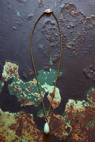 chalcedony and coral on brass by denise carbonell