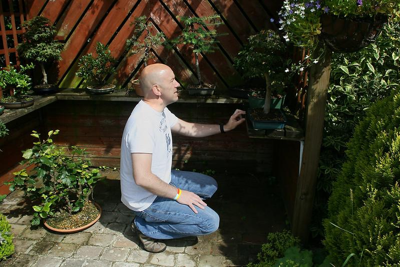 Ian Inspecting a tree.