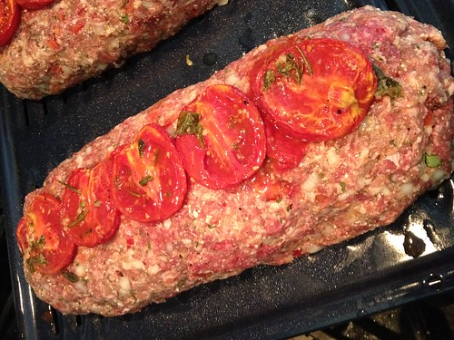 Fresh roasted tomatoes on the meatloaf