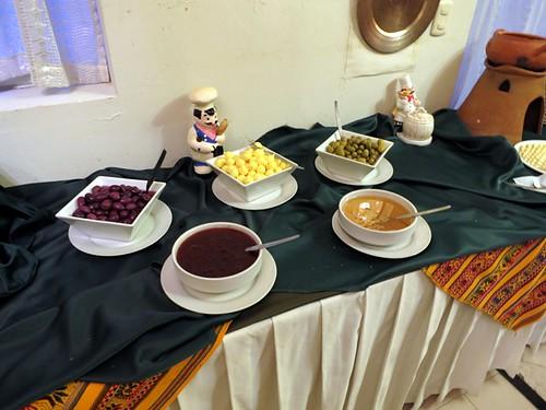 Breakfast buffet (olives, butter, jams)