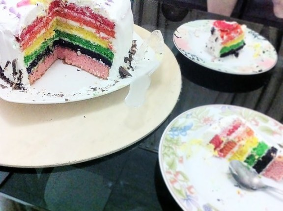 ultradino rainbow cake slice