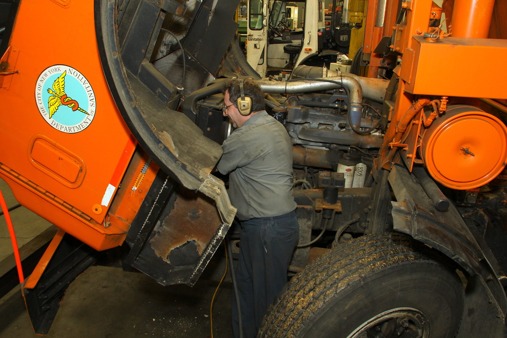 Mechanic Maintains Vehicle