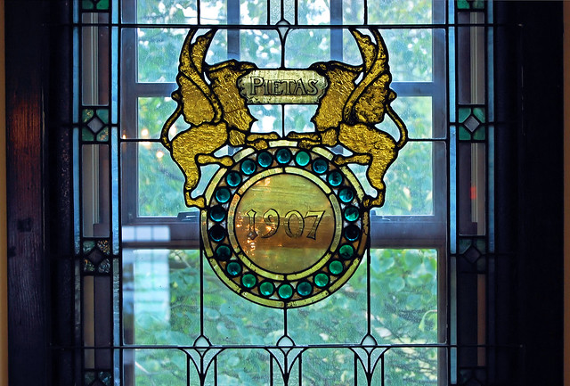 Griffins & Shield window in Ambrose Hall