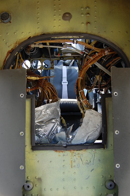 looking up through wires to seat and harness for pilot