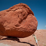 Jenn holds up a boulder outside Canyonlands National Park