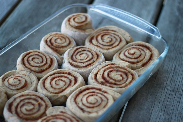 Glass pan with unbaked pumpkin cinnamon rolls.