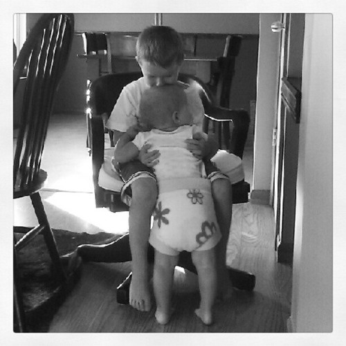 Baby Big Butt's first goal of the day is to find her brothers. She by passed me and headed straight for him. #bigbutt #clothdiapers #brotherlylove