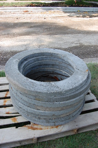 stack of cement forms for manhole rings