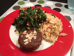 Sautéed spinach & tomatoes with saffron-garlic rice and tofu burger