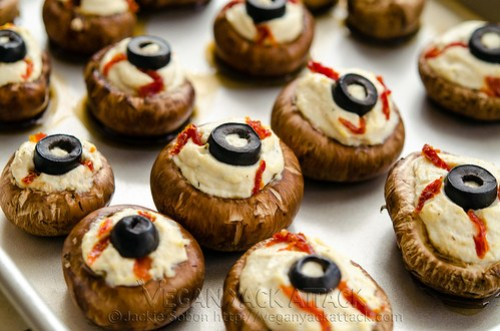 Mmm.. Delicious eyeballs! No, no cannibalism here, just some Stuffed Mushroom Eyeballs, filled with a garlicky tofu ricotta!