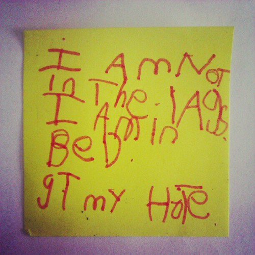 "Post-it note left on the bench last night from Miss 5.  The translation is ""I am not in the lounge. I am in bed. Get my hottie"". #demandingbutcute #subtlelikehermum"