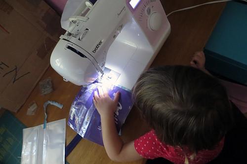 helping me sew