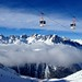 Telecabine above the Aiguilles Rouge & a temperature inversion creeping in