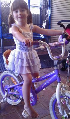 Miss H & her new bike...