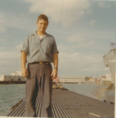 Gary standing on a naval submarine
