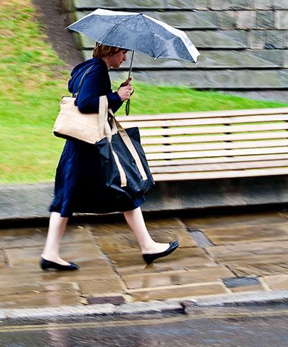 • Hurrying in the rain •