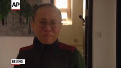 AP - Wife of Chinese Nobel Prize Winner Speaks Out