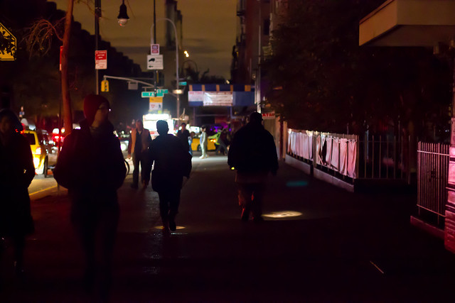 People walking back to their dens with flashlights in hand.