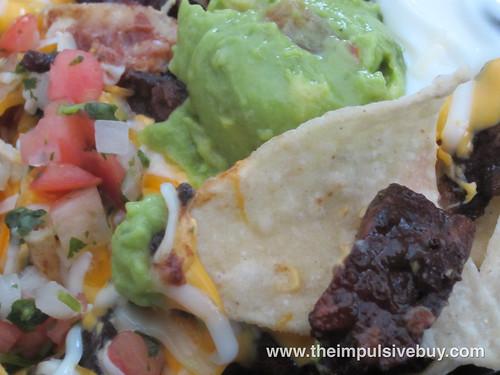 Taco Bell XXL Steak Nachos Guac Closeup