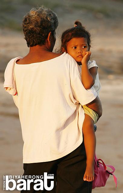grandmother and baby in nagbalayong beach morong bataan