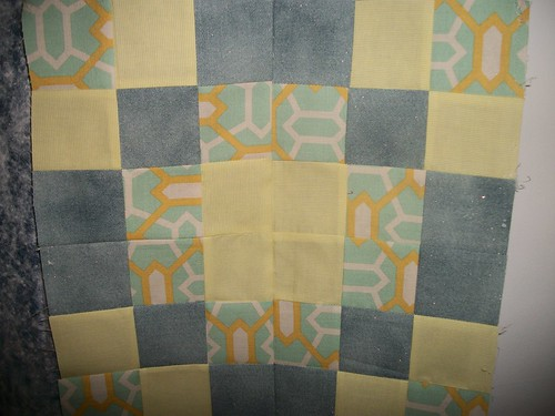 Yellow, grey, and aqua quilt block