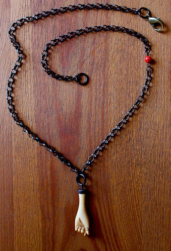 carved bone hand & coral on a blackened brass chain @ metal and thread by denise carbonell