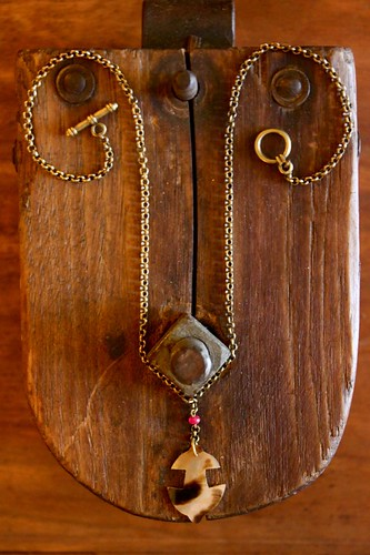 carved abalone shell anchor on brass @ metal and thread by denise carbonell
