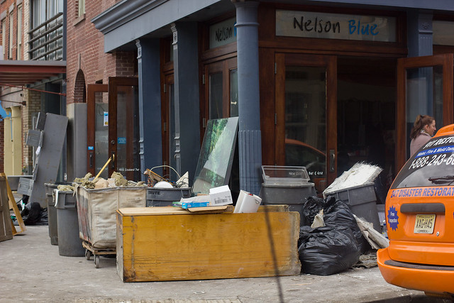 Shopkeepers were hard at work throwing out damaged furniture.