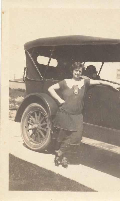 Aunt Rose leaning on Jack G's car