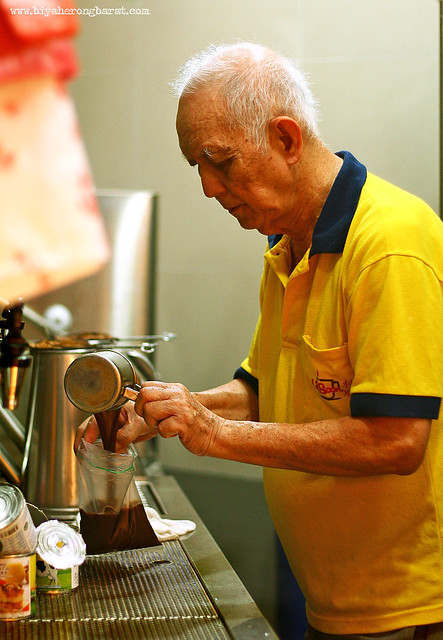 Uncle making kopi Singapore